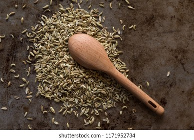 A measuring spoon of fennel seeds