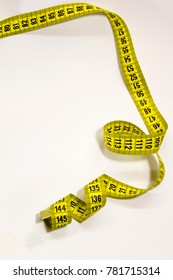 Measuring tape for the body on a white background.