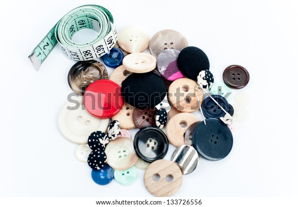 measuring tape and buttons