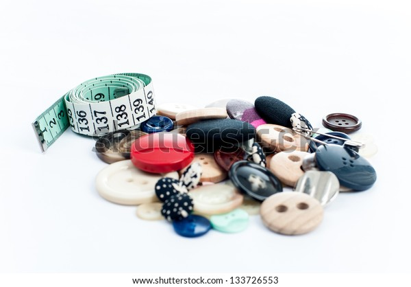 measuring tape and colorful  buttons