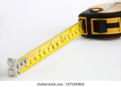 The measuring tape is isolated from the white background