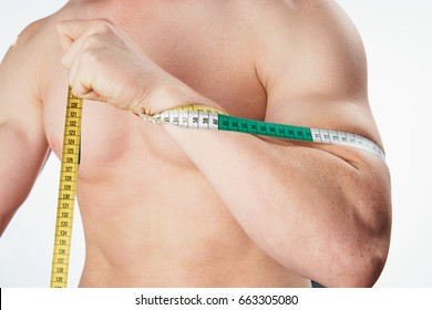 Measuring tape, man with measuring tape, sports man on isolated background