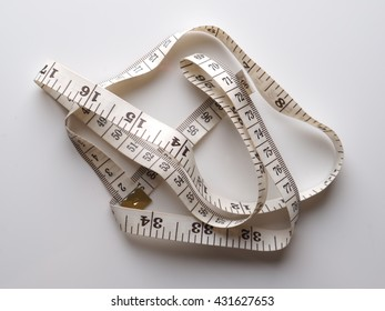 measuring tape on a gray background