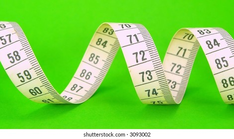 Measuring Tape On A Green Background