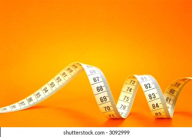 Measuring Tape On Orange Background