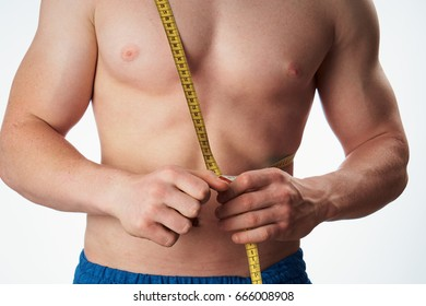 Measuring tape, strong man on a light background