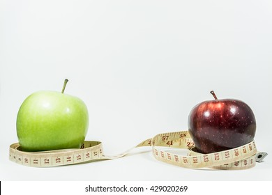 Measuring tape wrapped around two apples. Concept of diet.