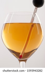 Measuring White Wine Temperature with a Wine Thermometer. Close-up