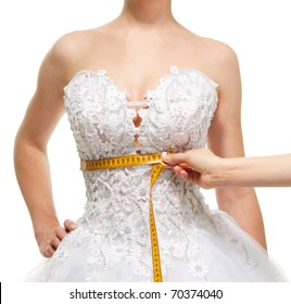Measuring woman's waist under the breast with centimeter, isolated on white