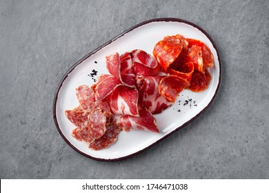 Meat appetizer plate, assortment of antipasti meat, jamon, chorizo, pepperoni, prosciutto Meat appetizer plate, assortment of antipasti meat, jamon, chorizo, pepperoni, prosciutto