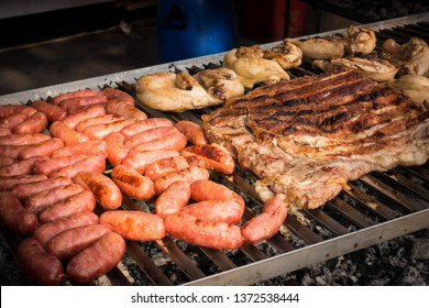 Meat baked on the grill. Sausages homemade sausages on the grill. Street food. Festival of street food and meat