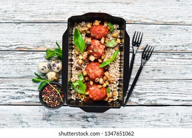 Meat balls baked in tomato sauce with buckwheat. Weight loss nutrition in boxes. Top view. Free space for your text.