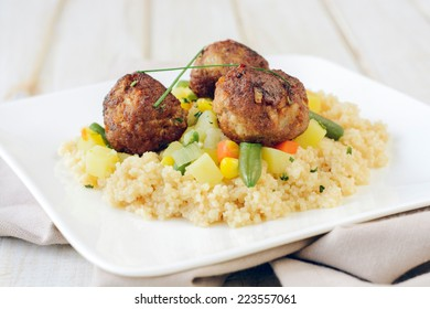 Meat balls with couscous and vegetables,selective focus