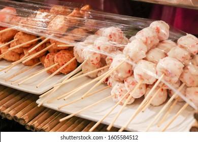 meat balls and crab balls on sticks