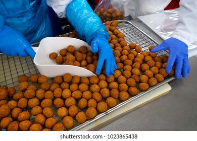 Meat balls on food conveyor ready for packaging.