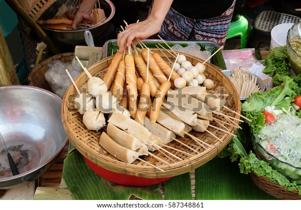 Meat balls and sausages. Thai snack, meat balls fish balls and sausages are steaming on wooden tray.