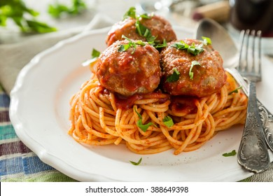 Meat balls and spaghetti on white plate, rustic wood background