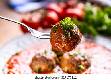 Meat balls with tomato sauce.