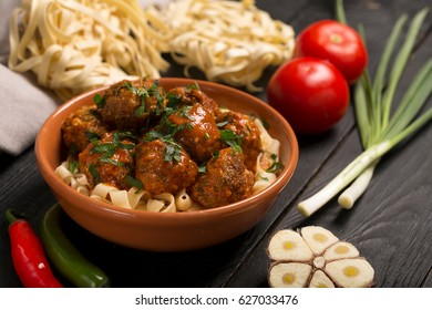 Meat balls with tomato sauce and pasta, close-up