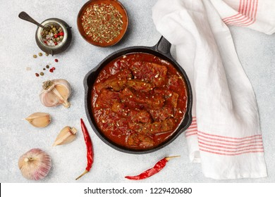 Meat (Beef) stewed in tomato sauce with garlic and spices. Goulash. Delicious hearty dinner for gourmets. Selective focus