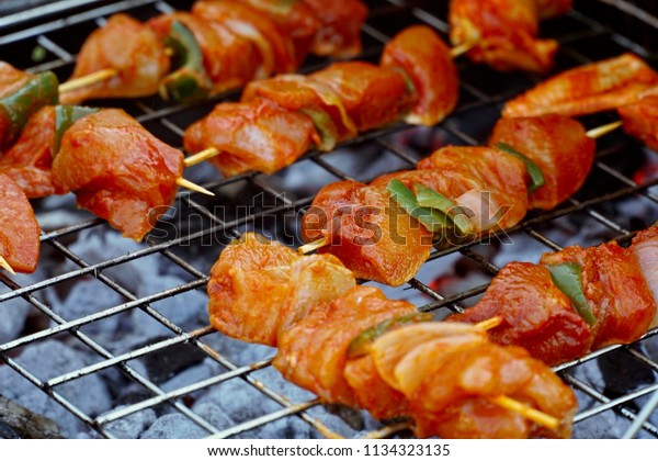 Meat brochettes on the grill