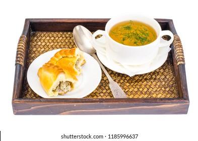 Meat broth with pie. Studio Photo