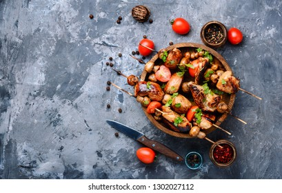 Meat chicken shish kebab with mushrooms.Fast food