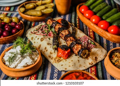 Meat Eggplant Kabab. Eaten in the elderly village session. A delicious eggplant kebab among the eggs. Baku Azerbaijan. October 5, 2016