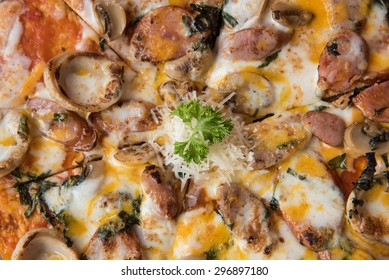 Meat feast Barbecue pizza with a topping of pepperoni and sausage