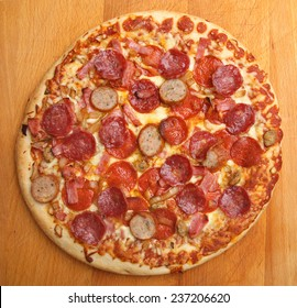 Meat feast pizza with pepperoni, ham and spicy sausage topping.