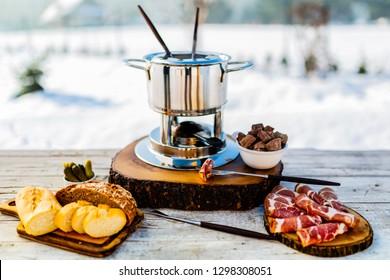 Meat fondue, traditional Swiss dish.