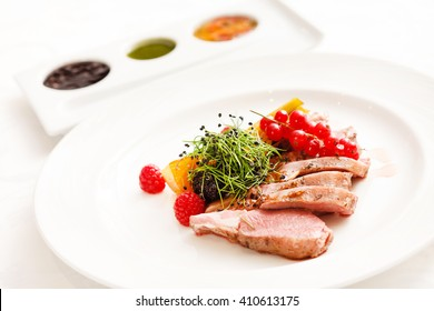 meat with fresh berries