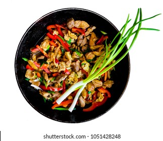 Meat fried vegetables chinese food in a frying pan on a white background