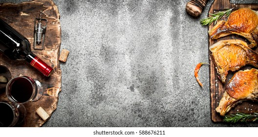 Meat grill. Fried steak of pork with red wine and spices. On rustic background.
