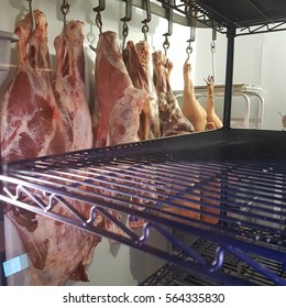 Meat hanging in a cold locker
