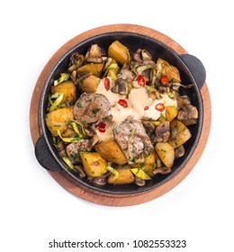 Meat hot frying pan with potatoes, vegetables and meat isolated on a white background. top view