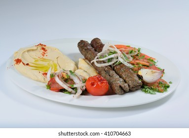 Meat kabab arabic food with kubus and hummus