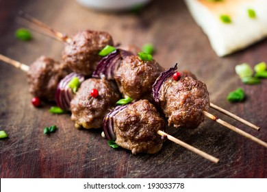 Meat kebab, beef balls on skewer with onions, avocado sauce guacamole, spring picnic