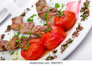 Meat kebab served in plate