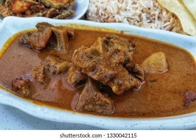 Meat lamb mutton curry served with Biryani rice. Malaysian street food a delicious Indian mutton curry on table setup.