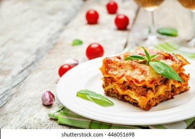 Meat lasagna on a white wood background. toning. selective focus