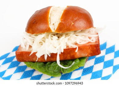 meat loaf in a pretzel roll with coleslaw