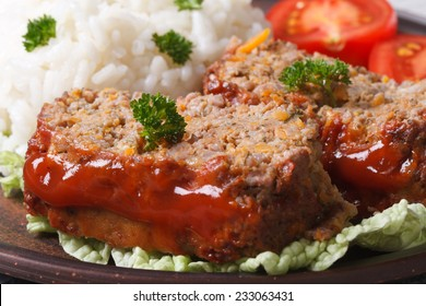 meat loaf with rice and vegetables on a plate macro horizontal