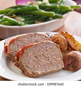 Meat loaf with roasted herb potatoes meal