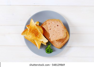 meat loaf with toasts on grey plate