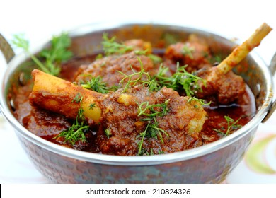 Meat, mutton or chicken curry dish in a copper brass bowl