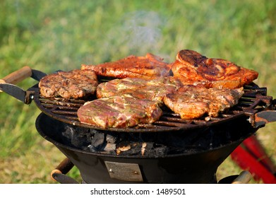 meat on barbecue, white smoke