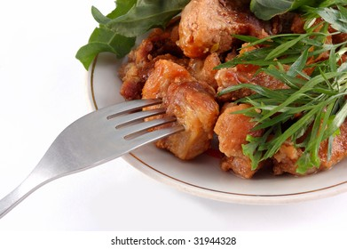 meat on a dish with a fork