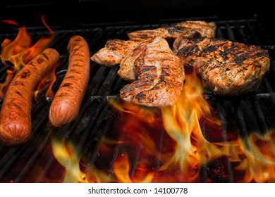 meat on the grill with flames