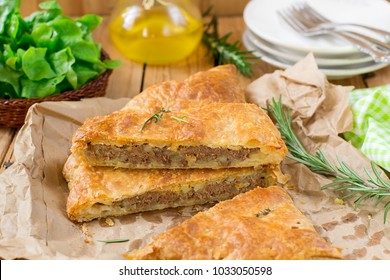 Meat pie with puff pastry, minced beef, onions and potatoes
